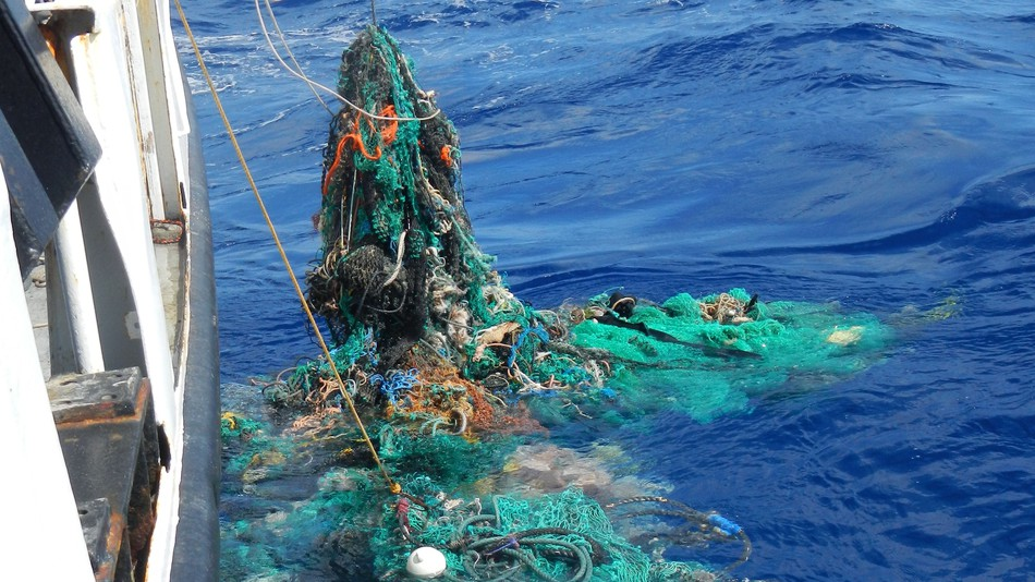 Ghost fishing net catching and pulling onboard